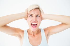 angry-blonde-screaming-and-holding-her-head