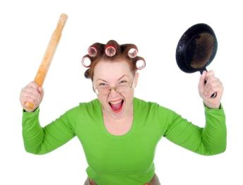 angry-housewife-in-hair-rollers-is-holding