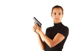 cute-young-woman-with-pistol-isolated