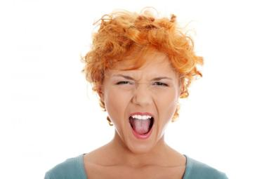 furiouse-young-redhead-woman-screaming