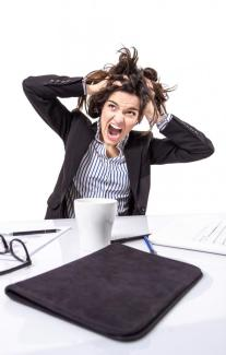 stressed-business-woman-screaming-and-pulling-hair