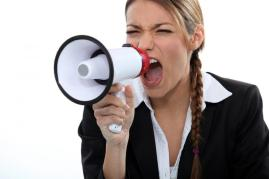woman-shouting-through-a-loudspeaker