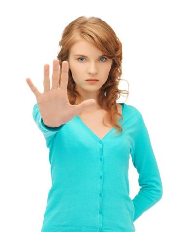 young-woman-making-stop-gesture-1